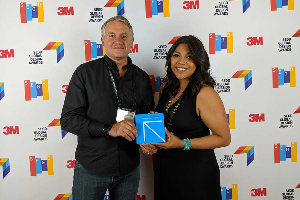 Jim Spadaccini and Michelle Lowden accepting the SEGD Award in Minneapolis.