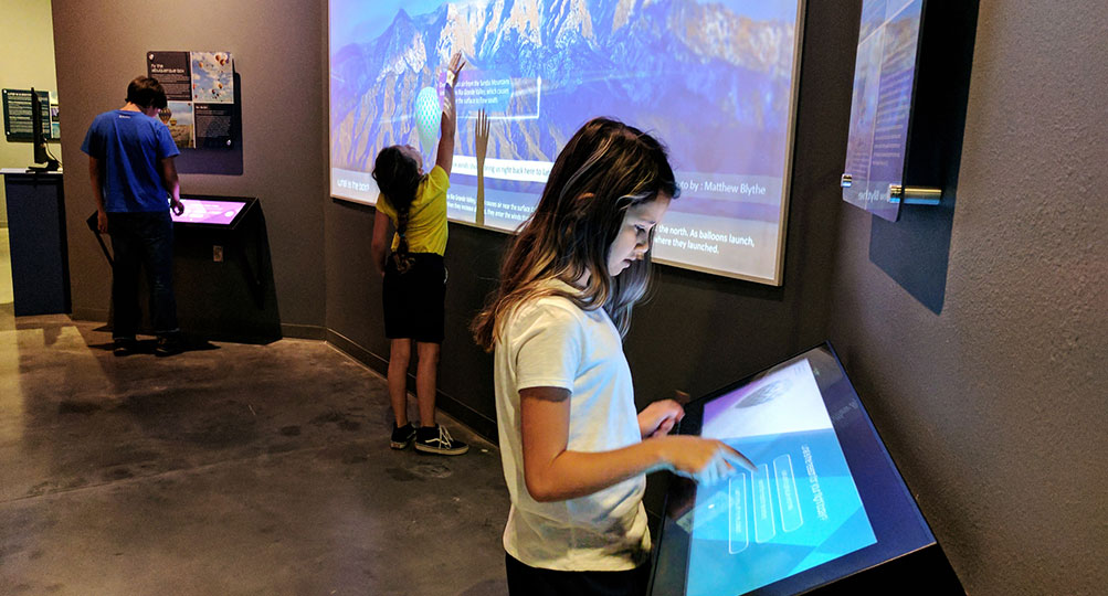 Museum Visitors Explore the Weather Lab