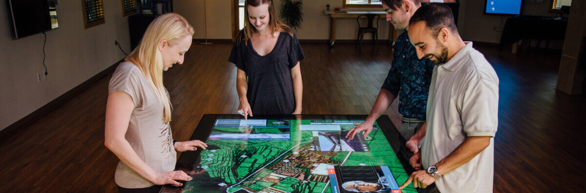 "Completely redesigned, the Colossus II is an 86"" 4K Ultra High Definition (UHD) multitouch table designed for demanding spaces, impervious to light interference, and large enough for up to eight people to interact with it simultaneously."