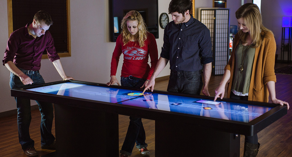 Giant Multitouch Tables: Pano vs. Colossus