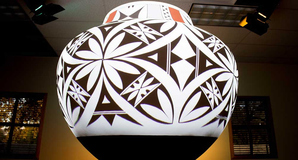 Classic Acoma Pueblo design projection mapped onto large pottery.