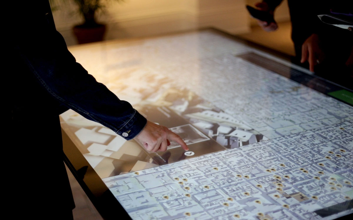 Visitors use an Ideum multitouch table to take an interactive tour of the New Orleans French Quarter.