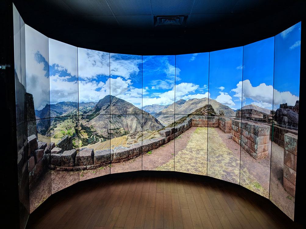 An immersive video wall displaying a panoramic image from Cusco.